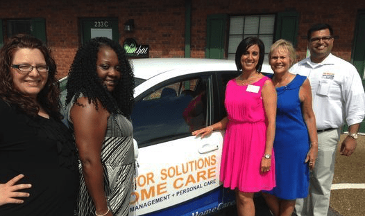Group next to Senior Solutions Car